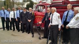 Members, active and retired posing for pictures with Brush 75 during Lineboro Volunteer Fire Department's 100th year anniversary in 2015.